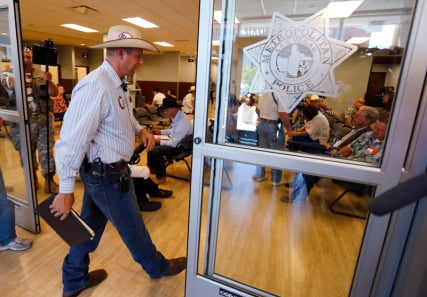 Ammon Bundy, son of rancher Cliven Bundy, files a criminal complaint against the Bureau of Land Management at the Las Vegas Metropolitan Police Department in Las Vegas, Nevada on May 2, 2014. Photo courtesy of REUTERS/Mike Blake