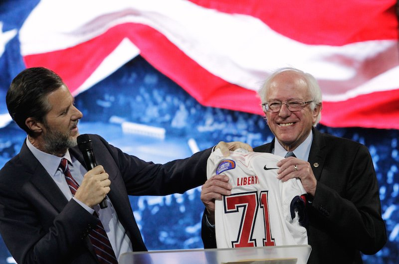 U.S. Democratic presidential candidate Sen. Bernie Sanders (I-VT) receives a football jersey from Jerry Falwell Jr. (L), president of Liberty University after addressing students in Lynchburg, Virginia September 14, 2015. REUTERS/Jay Paul - RTS12EG