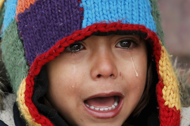 A child cries from the cold at a registration camp for migrants in Presevo, Serbia REUTERS/Marko Djurica
