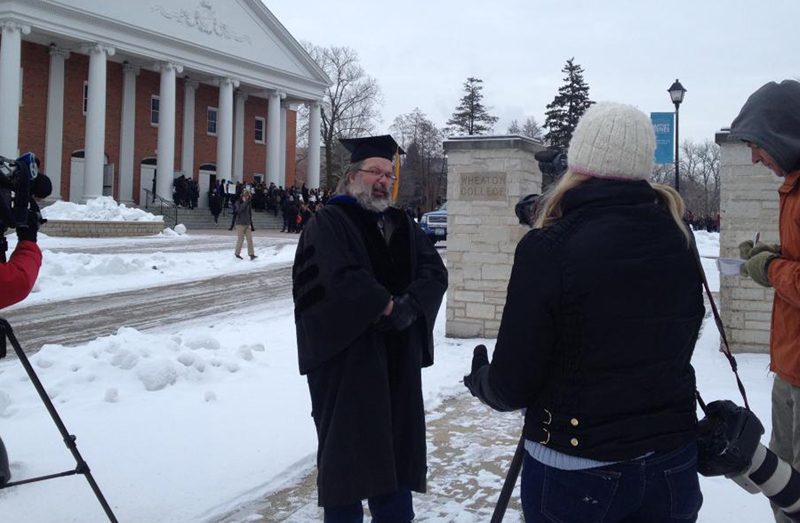 Wheaton College professor Michael Mangis speaks to the media off campus as students protest the school's actions against fellow professor Larycia Hawkins, who has said Christians and Muslims worship the same God. Religion News Service photo by Emily Miller