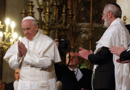 Pope Francis gestures at the end of his visit at Rome's Great Synagogue, Italy January 17, 2016. Photo by Alessandro Bianchi courtesy of Reuters
