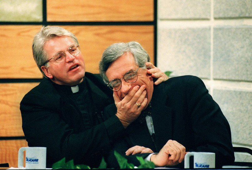 """Monsignor Thomas Hartman, left, and Rabbi Marc Gellman share a light moment after one of their television appearances as the """"God Squad"""" on Nov. 14, 1996. Photo by Karen Wiles Stabile, courtesy of Newsday *Editors: This photo is not available for republication in web or print, and may only be used one time on the RNS website with RNS-SALKIN-COLUMN, originally published on Feb. 18, 2016."""