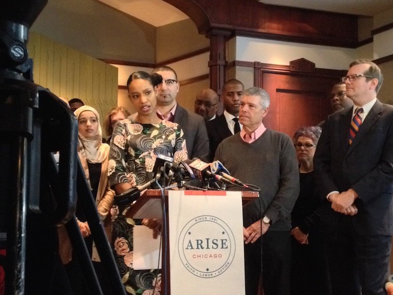Professor Larycia Hawkins at a press conference Feb. 10, 2016, in which she announced her departure from Wheaton College. Wheaton College president Philip Ryken stands at right. RNS photo courtesy Emily McFarlan Miller