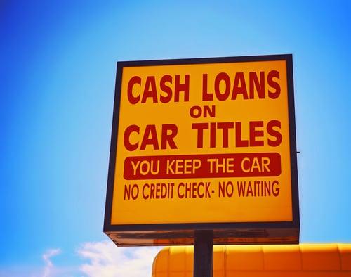 A cash loan or car title loan sign.