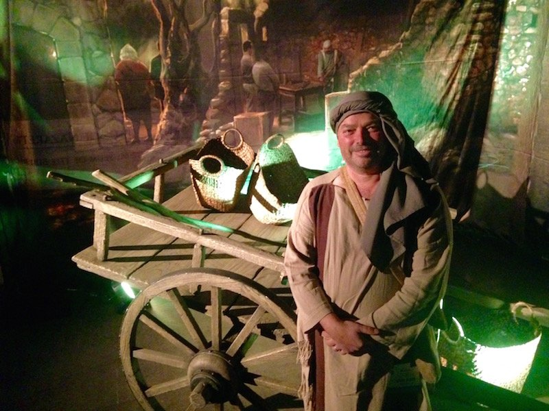 Daniel Stenger poses in front of a replica of a cart from first century Nazareth. A resident of modern-day Nazareth, Jesus' hometown, he's working as a guide in the Museum of the Bible Collection Preview. RNS photo courtesy Heidi Hall
