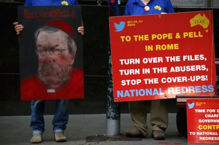 Victims and relatives of children who claim they were sexually abused by the Catholic Church hold placards as they stand outside the venue for Australia's Royal Commission into Institutional Response to Child Sexual Abuse in Sydney, Australia, February 29, 2016. Australian Cardinal George Pell on Monday becomes the highest-ranking Vatican official to testify on sexual abuse of children in the Catholic Church at a hearing that victims have flown half way around the world to attend. REUTERS/David Gray