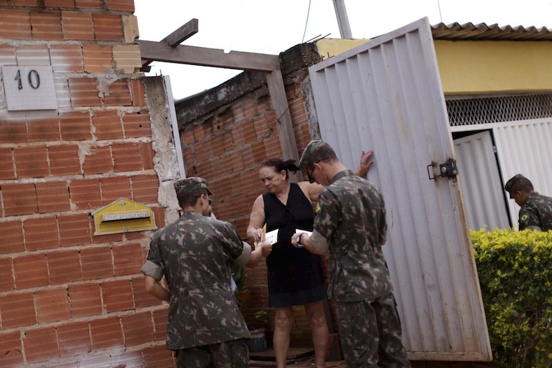 Brazilian soldiers hand out flyers as part of an awareness campaign to fight the Aedes aegypti mosquito in the Sao Sebastiao neighbourhood in Brasilia, Brazil, February 15, 2016. Photo courtesy REUTERS/Ueslei Marcelino *Editors: This photo may only be republished with RNS-BRAZIL-OB/GYN, transmitted on Feb. 26, 2016.