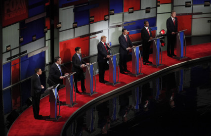Republican U.S. presidential candidate businessman Donald Trump, center, speaks as he stands amongst six rivals for the Republican presidential nomination during the Fox Business Network Republican presidential candidates debate in North Charleston, South Carolina on January 14, 2016. Photo courtesy of REUTERS/Randall Hill *Editors: This photo may only be republished with RNS-DEBATE-PREVIEW, originally transmitted on Jan. 27, 2016.