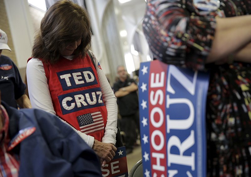 Supporters of U.S. Republican presidential candidate Senator Ted Cruz (R-TX) pray at the start of a campaign event in Columbia, South Carolina on February 16, 2016. Photo courtesy of REUTERS/Joshua Roberts *Editors: This photo may only be republished with RNS-FARNSLEY-COLUMN, originally transmitted on Feb. 23, 2016.