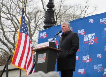 The Rev. Franklin Graham, on the steps of the Columbia, S.C., Statehouse for part of his 50-state Decision America tour, calls on an audience of 7,100 to pray and vote for evangelical Christian candidates and run for office themselves. Religion News Service photo by Cathy Grossman