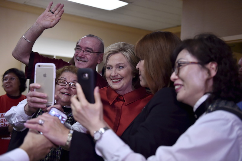 U.S. Democratic presidential candidate Hillary Clinton meets casino employees on her way to victory in the Nevada caucus. 2016. REUTERS/David Becker -
