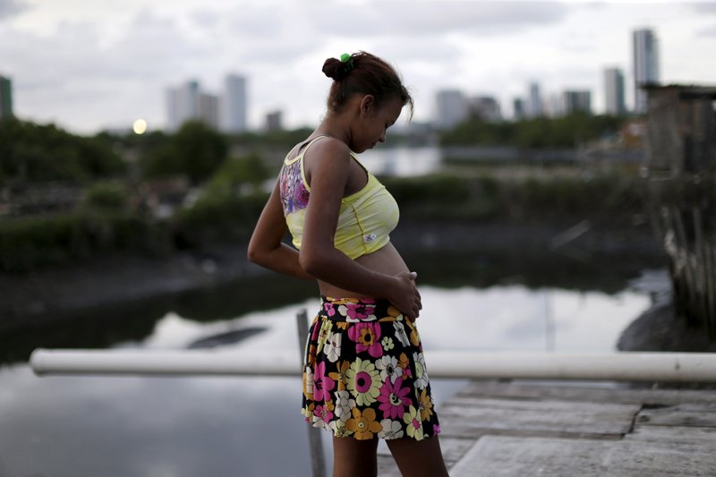 Eritania Maria, who is six months pregnant, is seen in front of her house at a slum in Recife, Brazil, on February 2, 2016. The Zika outbreak has revived the debate about easing abortion laws but Maria's case highlights a gap between campaigners and U.N. officials calling for change and Brazil's poor, who are worst affected by the mosquito-borne virus yet tend to be anti-abortion. Photo courtesy of REUTERS/Ueslei Marcelino *Editors: This photo may only be republished with RNS-KNOLL-COMMENTARY, originally transmitted on Feb. 11, 2016.