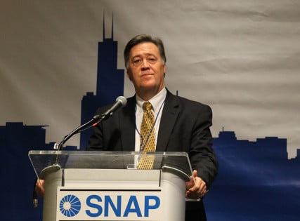 Jason Berry addresses a SNAP meeting in Chicago in July 2014. Photo by Brian Roewe, courtesy of National Catholic Reporter