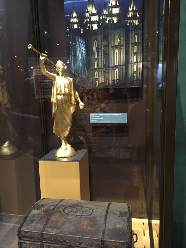 A statue of Mormonism's Angel Moroni and in the foreground, Mormon leader Brigham Young's suitcase. Photo by Susan Goldstein/Religion & Ethics NewsWeekly