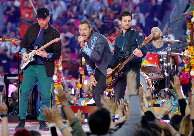 Chris Martin, center, lead singer of Coldplay, performs with the band during the half-time show at the NFL's Super Bowl 50 between the Carolina Panthers and the Denver Broncos in Santa Clara, California on February 7, 2016. Photo courtesy of REUTERS/Mike Blake *Editors: This photo may only be republished with RNS-SHULKA-COLUMN, originally transmitted on Feb. 9, 2016.