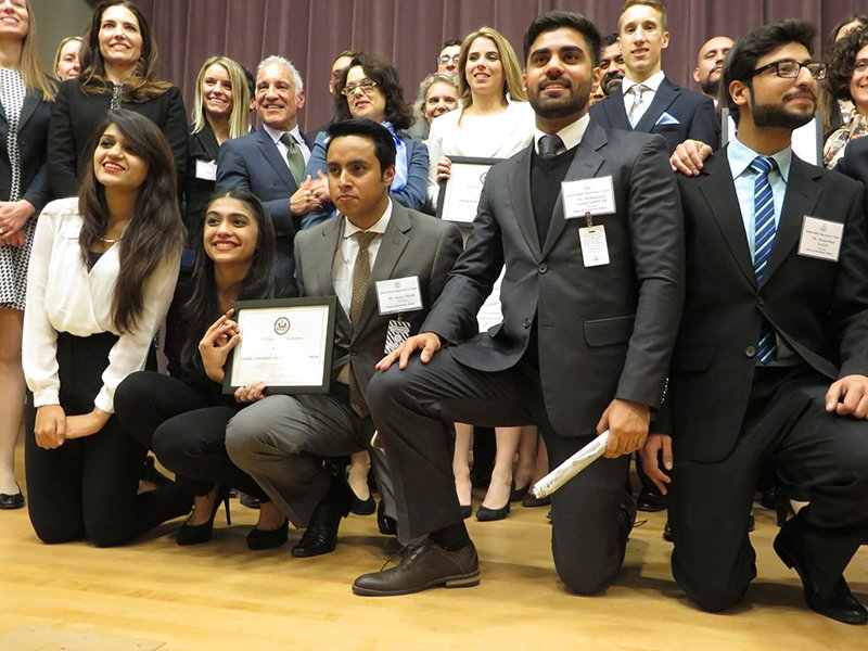 In the front row, from the Lahore University of Management Sciences, Lahore Pakistan, are the first prize winners of the State Department's Peer to Peer contest for combatting violent extremism. The students won their award at the finals of the international competition for college students, held at the State Department on Jan. 2, 2016. Behind them are cadets from the United States Military Academy West Point, the second place winners. In all, 45 teams from universities around the world competed. Religion News Service photo by Lauren Markoe