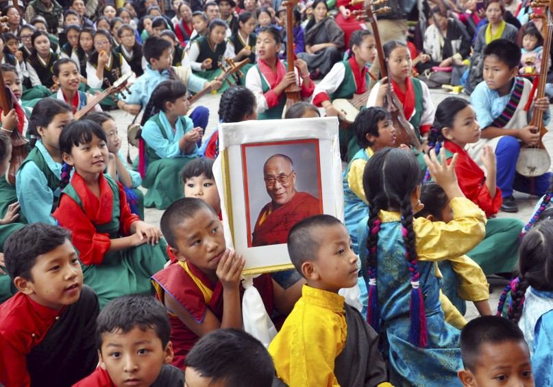 A young Tibetan monk holds a portrait of their spiritual leader, the Dalai Lama, during celebrations marking his 80th birthday anniversary in the hill town of Dharamsala, India, in this July 6, 2015 file photo. REUTERS Photo.