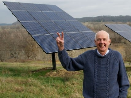 Wendell Berry stands before the solar panels on his farm in Henry County, Ky.