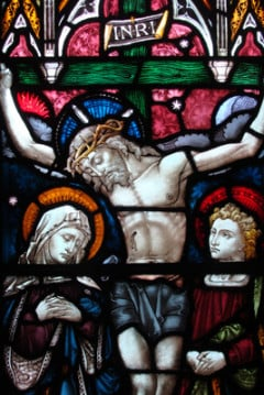 (RNS) A stained glass window at St. Andrew's Episcopal Cathedral in Honolulu, Hawaii, depicts the crucifixion of Jesus. RNS photo by Kevin Eckstrom.