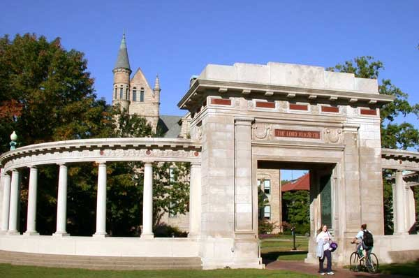 Students passing through the Oberlin Memorial Arch in front of Peters Hall.