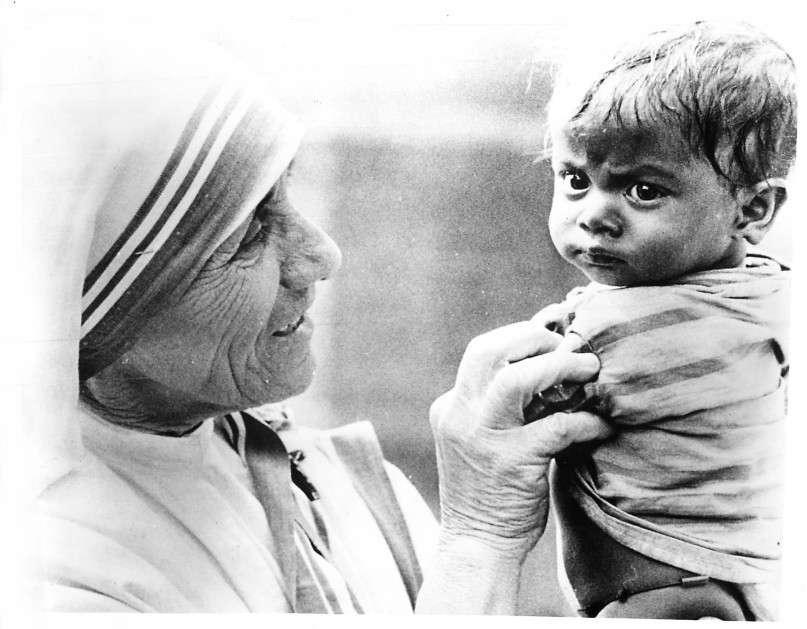 "(1977) Mother Teresa of Calcutta, shown with an Indian child, worked to help sick and homeless victims in the cyclone-ravaged Indian state of Andhra Pradesh. She said her Missionaries of Charity nuns have ""all the experience necessary to work in this disaster area because of previous efforts during floods."" ""In all these human tragedies, God is trying to teach us something. We are not able to understand Him,"" she said as she went about supervising the rescue operation. Religion News Service file photo"