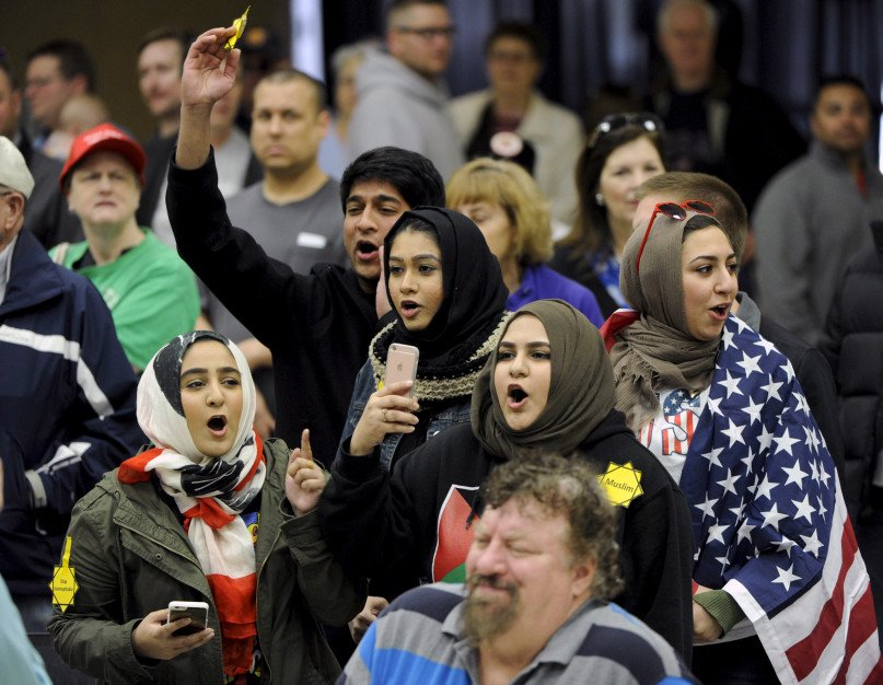 Young Muslims in Wichita protest U.S. Republican presidential candidate Donald Trump at a Wichita, Kansas, campaign rally in March 5, 2016. Laywers for three men on trial in Wichita Jan. 4, 2018, for allegedly plotting to bomb a Muslim neighborhood in rural Kansas, want rural Trump voters on the jury. Photo courtesy of REUTERS/Dave Kaup