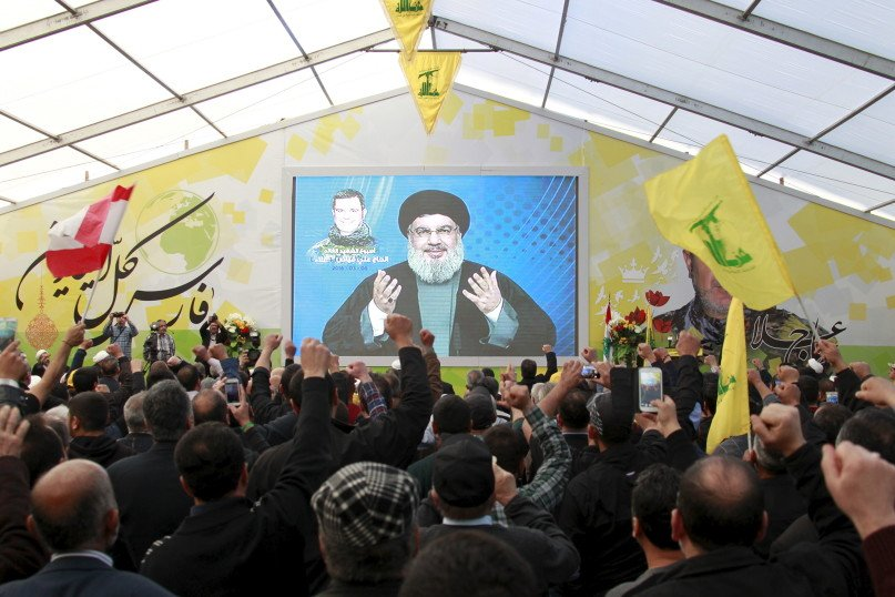 Lebanon's Hezbollah leader Sayyed Hassan Nasrallah addresses his supporters via a screen during a commemoration service marking one week since the death of Ali Fayyad, one of Hezbollah's senior commanders killed fighting alongside Syrian army forces in Syria, in Ansar village, southern Lebanon March 6, 2016. REUTERS/Aziz Taher - RTS9J74