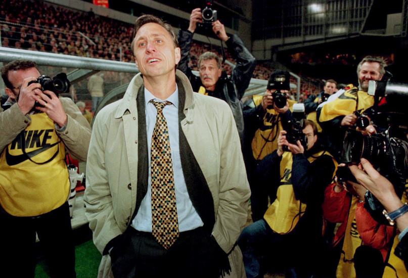 Barcelona Dutch coach Johan Cruyff looks on as he is surrounded by photographers after his team defeated Dutch PSV Eindhoven in the second leg of the UEFA Cup quarter final match in Eindhoven, March 19. Photo courtesy of Reuters.