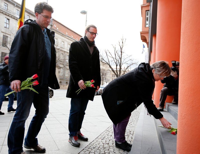People place flowers for the victims of the Brussels attacks, in front of the Belgian embassy in Berlin, Germany, on March 22, 2016. Photo courtesy of REUTERS/Fabrizio Bensch *Editors: This photo may only be republished with RNS-BELGIUM-REACTION, originally transmitted on March 22, 2016.