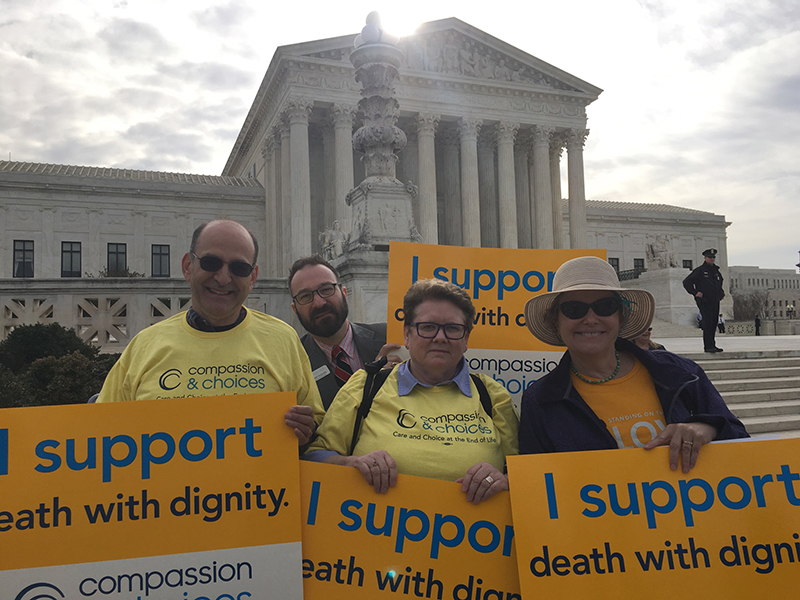 Left to right, Bill Snyder, Jared Hughes, Carla Lehn and Alexa Fraser, demonstrators from Compassion & Choices, a group that advocates for the legalization of physician-assisted dying, which is opposed by the same religious groups that oppose the contraception mandate, stand in front of the Supreme Court in Washington, D.C., on March 23, 2016. Religion News Service photo by Lauren Markoe