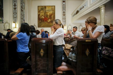 People pray while they attend the last mass at Church of Our Lady of Peace in New York 0n July 31, 2015. Photo courtesy of REUTERS/Eduardo Munoz *Editors: This photo may only be republished with RNS-GENDER-RELIGION, originally transmitted on March 22, 2016.