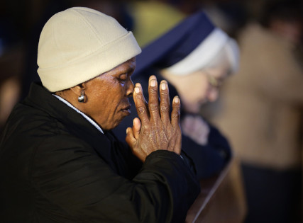 A woman and a nun pray during an early morning mass at Regina Mundi Church in Soweto on June 30, 2013. Photo courtesy of REUTERS/Kevin Coombs *Editors: This photo may only be republished with RNS-GENDER-RELIGION, originally transmitted on March 22, 2016.