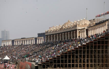 People sit on the steps of a stage at the venue of World Culture Festival on the banks of the Yamuna river in New Delhi, India, on March 10, 2016. Indian environmentalists are aghast that a huge cultural festival is to be held on the floodplain of Delhi's main river from Friday, warning that the event, and the 3.5 million visitors expected, will devastate the area's biodiversity. Photo courtesy of REUTERS/Anindito Mukherjee