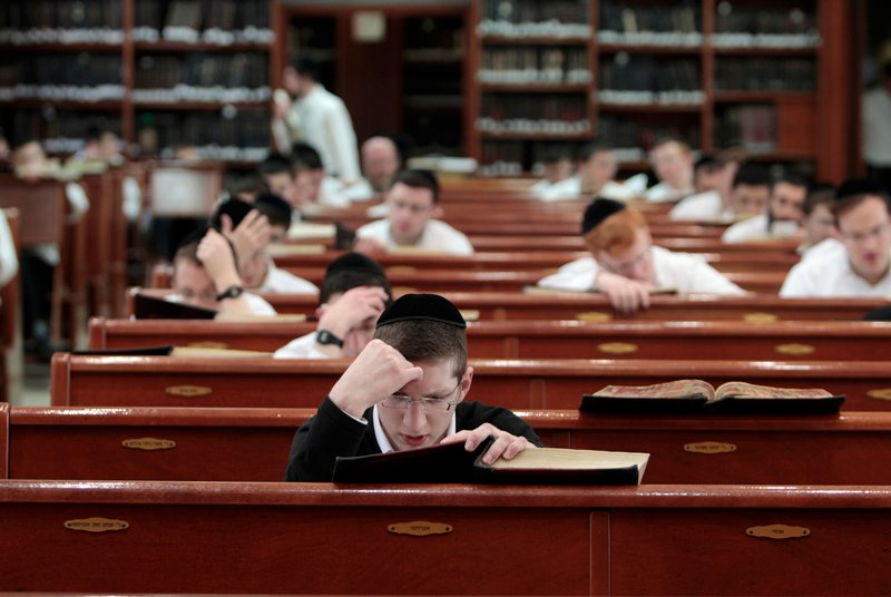 "Ultra-Orthodox Jewish youths study religious texts at a synagogue in Jerusalem on April 7, 2011. Ultra-Orthodox Jews, or ""Haredim"", are a devout tight-knit community who make up 8-10 percent of Israel's 7.7 million population, with eight children per family on average. Photo courtesy of REUTERS/Baz Ratner *Editors: This photo may only be republished with RNS-ISRAEL-POLL, originally transmitted on March 8, 2016."