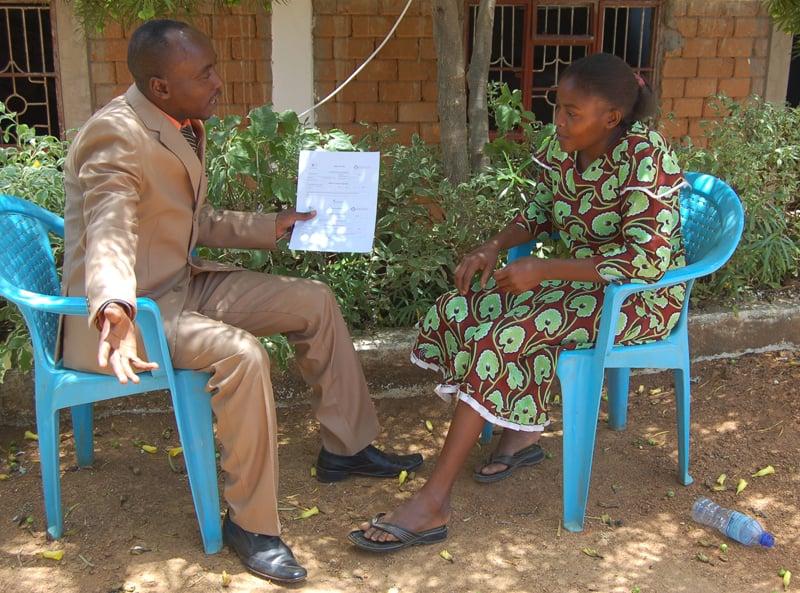 Pastor Ezekiel Musembi, the general secretary of the Makueni Pastors Foundation and Elizabeth Muendo, a community health worker in Makueni County speak on March 28, 2016. Religion News Service photo by Fredrick Nzwili