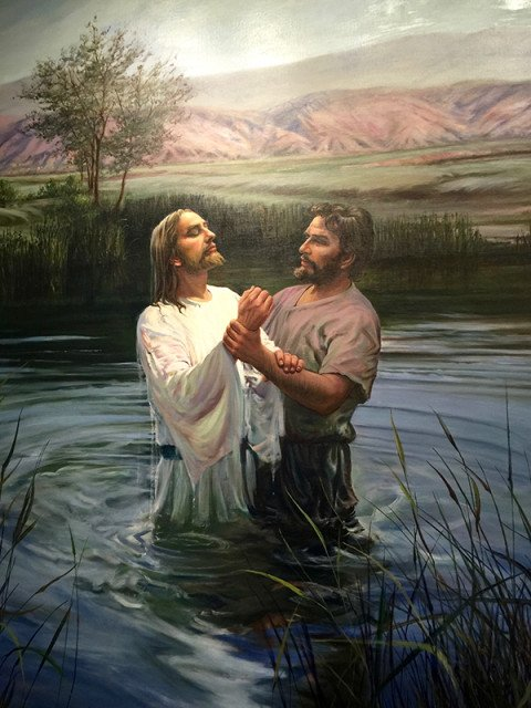 "At the Church of Jesus Christ of Latter-day Saints' visitors center in Salt Lake City,  ""The Baptism of Jesus"" by Harry Anderson presents John baptizing Jesus as though it happened between two mountain men in the valleys of the American West, reinforcing the early church's idea of its history as a very American story. Religion News Service photo by Kimberly Winston"