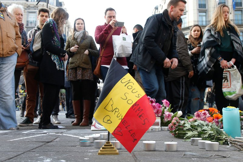 People gather around a memorial in Brussels following bomb attacks s in Brussels, Belgium, on March 22, 2016. Photo courtesy of REUTERS/Charles Platiau