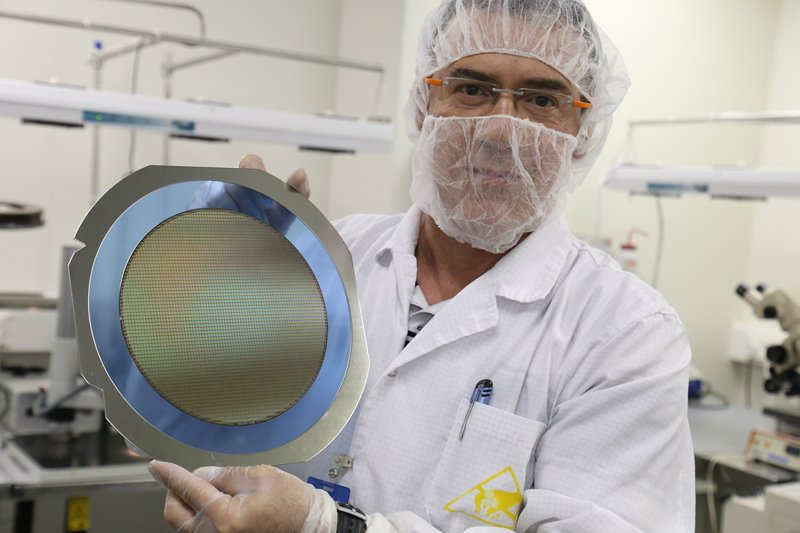 The Jerusalem Nano Bibles are made from silicon wafer, a thin slice of semiconductor material, derived from sand and generally used in precision printing of circuit boards. Photo courtesy of Jerusalem Nano Bible