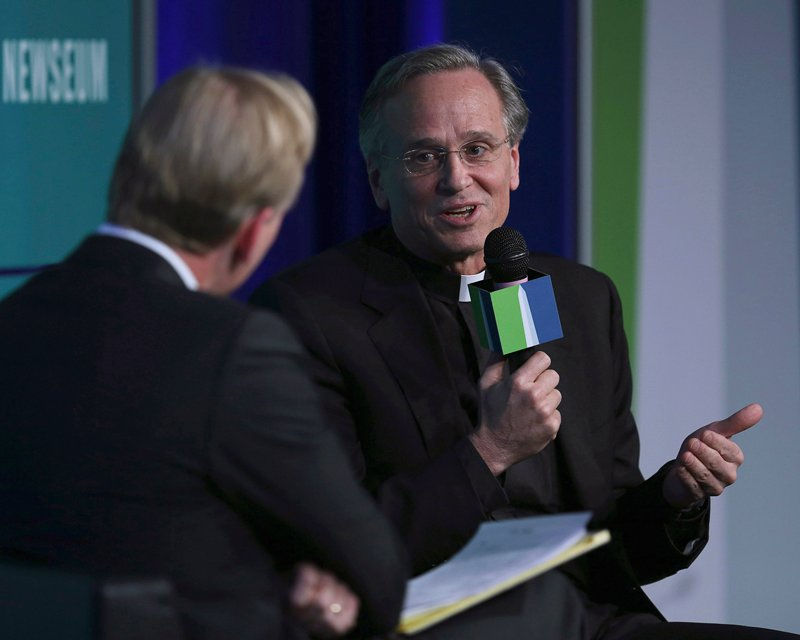 Rev. John Jenkins, right, president of Notre Dame University, speaks to John Dickerson at the fifth annual Washington Ideas Forum at the Newseum in Washington on November 13, 2013. Photo courtesy of REUTERS/Gary Cameron *Editors: This photo may only be republished with RNS-NOTREDAME-BIDEN, originally transmitted on March 7, 2016.