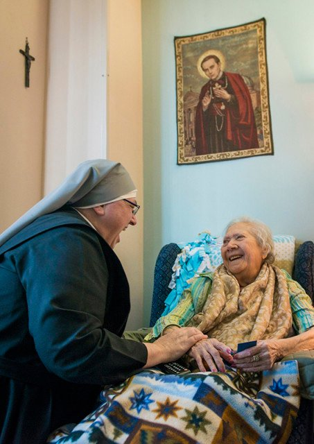 """Sister Constance Veit of Little Sisters of the Poor shares a laugh with resident Eva Howse, no age given, on Monday, March 21, 2016 in Washington, D.C. The Little Sisters of the Poor filed a complaint against the Affordable Care Actís contraceptive mandate in 2013. """"The common misconception is that Form 700 is an opt out by which we sign off that we object to these services and then we are removed from any association with them. But in reality, it's an opt in or a permission slip by which, if we were to sign it, we would be granting the government authorization to enter into our healthcare plan, to take it over, said Veit,"""" from the point of view of respecting the sincerely held religious beliefs of others, it's troublesome to me. I don't really understand how they could be taking a position that this is a compelling interest in our case for our relatively small number of employees when one hundred million people are exempt. It just does't really make sense."""" Their case will be argued in the Supreme Court on Wednesday. Photo by Jarrad Henderson, courtesy of USA Today"""