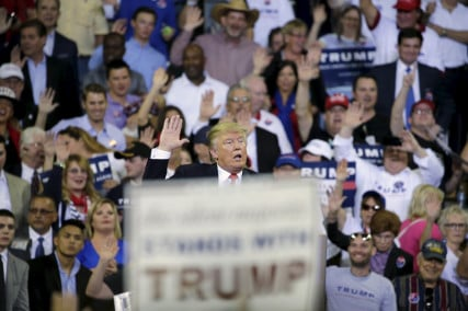 Republican U.S. presidential candidate Donald Trump asks his supporters to raise their hands and promise to vote for him at his campaign rally at the University of Central Florida in Orlando, Florida on March 5, 2016. Photo courtesy of REUTERS/Kevin Kolczynski