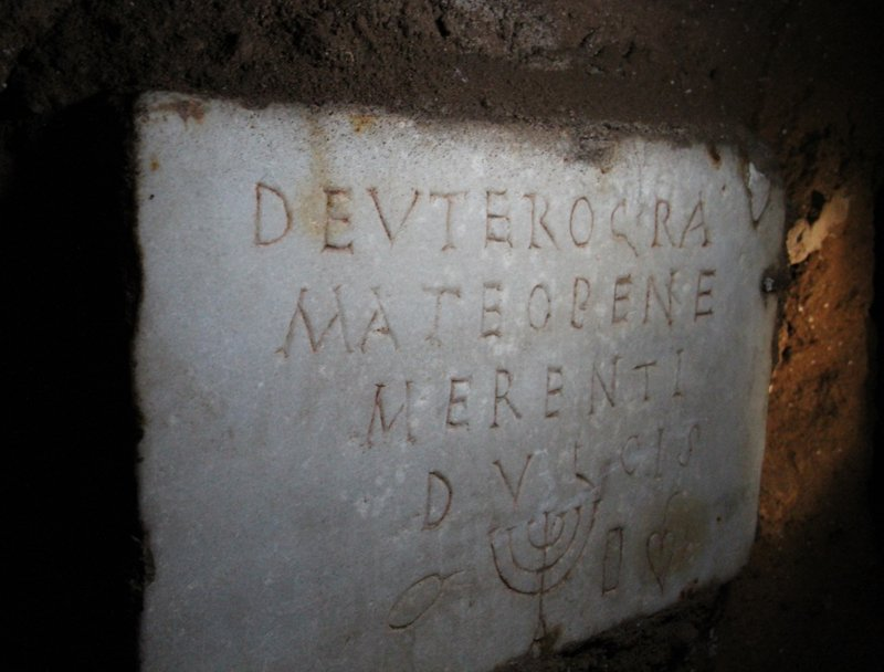 A grave marker inside the Jewish Catacombs in Rome with a depiction of a menorah. Religion News Service photo by Josephine McKenna