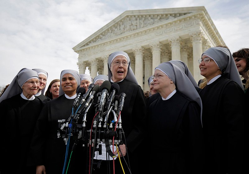 Sister Loraine McGuire with Little Sisters of the Poor speaks to the media after Zubik v. Burwell, an appeal brought by Christian groups demanding full exemption from the requirement to provide insurance covering contraception under the Affordable Care Act, was heard by the U.S. Supreme Court in Washington on March 23, 2016. Photo courtesy of REUTERS/Joshua Roberts *Editors: This photo may only be republished with RNS-SCOTUS-CONTRACEPTION, originally transmitted on March 23, 2016.