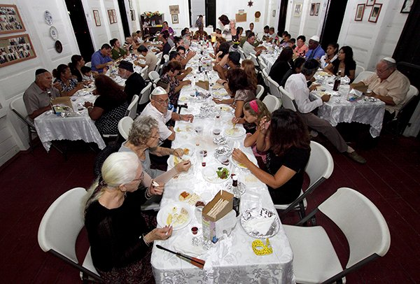 Surinamese Jews share the Passover Seder at the Neve Shalom Synagogue in Paramaribo on April 18, 2011. The Suriname Jewish community, considered as one of the oldest in the Americas, has only around 200 members. Photo courtesy of REUTERS/Ranu Abhelakh *Editors: This photo may only be republished with RNS-SEDER-SPLAINER, originally transmitted on March 24, 2016.