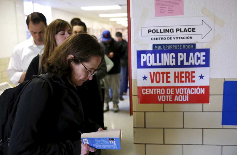 Virginia voters line up early to cast their ballots in Super Tuesday elections at the Wilson School in Arlington, Virginia on March 1, 2016. Photo courtesy of REUTERS/Gary Cameron *Editors: This photo may only be republished with RNS-SUPER-TUESDAY, originally transmitted on March 1, 2016.
