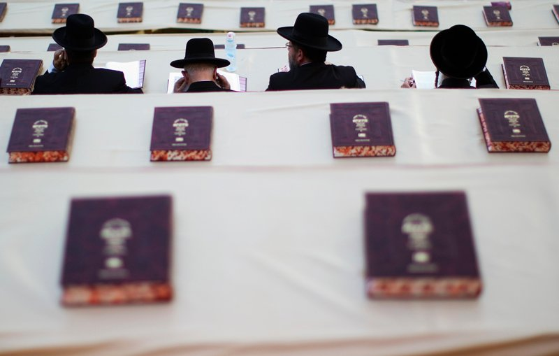 Ultra-Orthodox Jews attend a celebration marking the end of a seven-and-a-half-year cycle of studying texts from the Talmud, or a canon of religious law, in Jerusalem on July 30, 2012. Photo courtesy of REUTERS/Ronen Zvulun *Editors: This photo may only be republished with RNS-ORTHODOX-CONVERSION originally transmitted on April 1, 2016.
