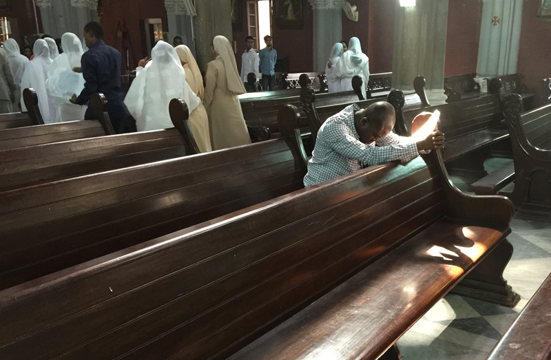 A man prays in the pews of Sacred Heart Cathedral in Lahore, Pakistan in Sept. 2015. Religion News Service photo by Kimberly Winston