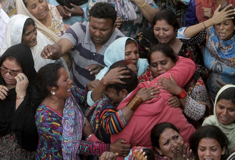 Family members mourn the death of a relative, who was killed in a blast outside a public park on Sunday, during a funeral in Lahore, Pakistan, on March 28, 2016. Photo courtesy of REUTERS/Mohsin Raza