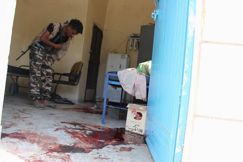 A pro-government militant checks a room floor stained with blood at an old people's home after it was attacked by gunmen in the Yemeni port of Aden March 4, 2016. Photo courtesy of REUTERS/Stringer *Editors: This photo may only be republished with RNS-YEMEN-NUNS, originally transmitted on March 4, 2016.