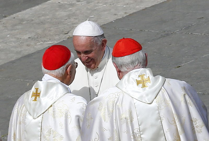 Pope Francis greets cardinals at the end of a Jubilee mass in Saint Peter's Square at the Vatican, April 3, 2016. REUTERS/Tony Gentile.